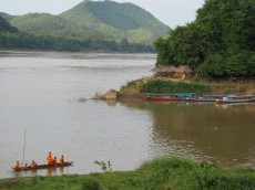 Monks travel by boat to the many temples located along the river